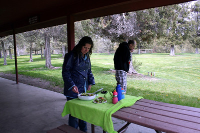 Lorinda tossing a salad for the picnic