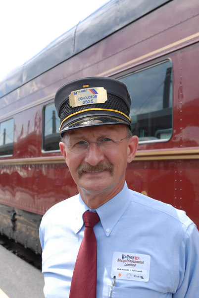 Conductor in front of PRR Business Car 120 at New Jersey Transit Hoboken Terminal