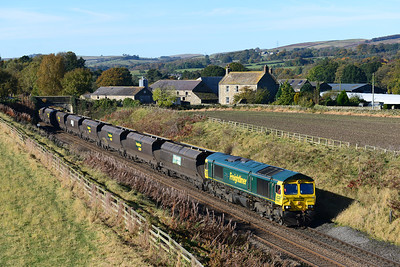 A Carlisle Yard-Holgate coal train heads East near Ridley Hall 21/10/12 hauled by 66957.