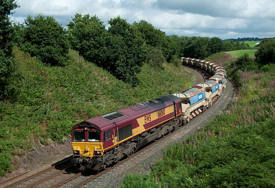 A Hexham-Carlisle train of auto-ballasters passes Cowran 2/9/12.