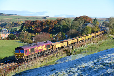 On a frosty morning a Heaton South Junction-Carlisle engineers train passes Gilsland hauled by 66015 10/11/13.