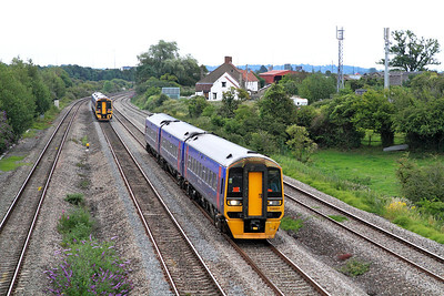 158957 forming the 14.23 Portsmouth Harbour to Cardiff Central passes Undy whislt 158961 passes in the opposite direction forming the 16.30 Cardiff Central to Portsmouth Harbour. 12/07/2011