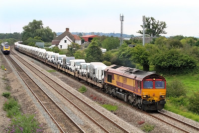 66019 passes Undy with 6X52 17.33 Portbury to Mossend car carriers which are loaded with Citroen & Peugeot vans and Honda cars bringing up the rear. 12/07/2011