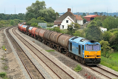 Running some 60 minutes late 60074 powers the 6B47 17.22 Westerleigh to Robeston empty Murco tanks along the slow at Undy. 12/07/2011