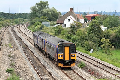 The 18.08 Taunton to Cardiff Central passes Undy formed of 153373 & 150261. 12/07/2011