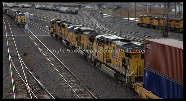Grteen River yard is a center of action with trains arriving and departing. Stack trains on the go.