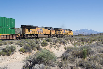 UP 7901and 4990 heads a hot Stack Train at Cima, CA, starting down the steep west slope