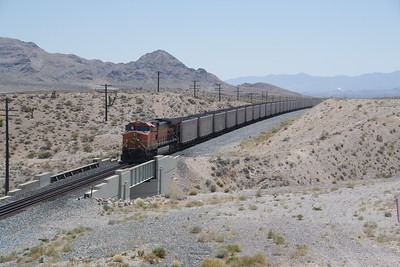 DPU 4494 going into dynamic as the train drops towards California at Jean, NV