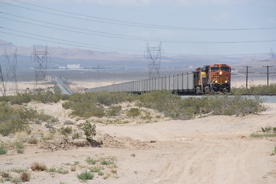 Primm, NV in the background, the WB train has crossed into California and begins the climb to Cima