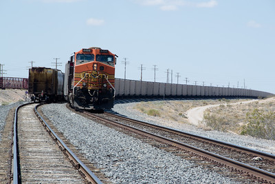 DPU BNSF 4494 shoves the rear of a westbound coal drag over the top at Apex, NV