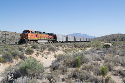 DPU BNSF 4494 in full dynamic as the train decends Cima Hill, at Cima, CA