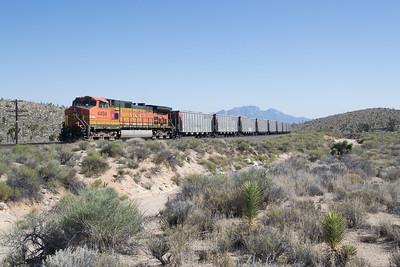 DPU BNSF 4494 in full dynamic as the train decends Cima Hill, at Cima, CA