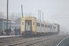 Polar Bear Express passenger consist alaong station platform. Six coaches and snack car.