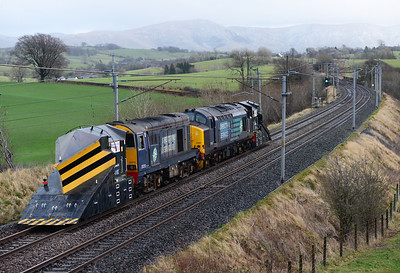 A shot for the record on Christmas Eve at Docker as 37405+20312 take the independent snow ploughs from Carnforth-Carlisle