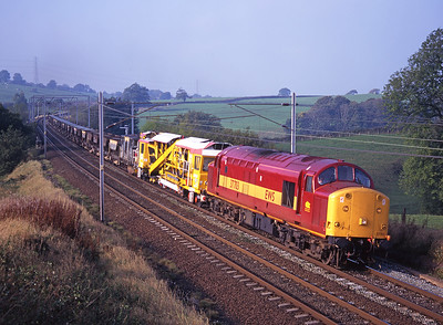 37703 passes Docker with an engineers train on 18/10/97.