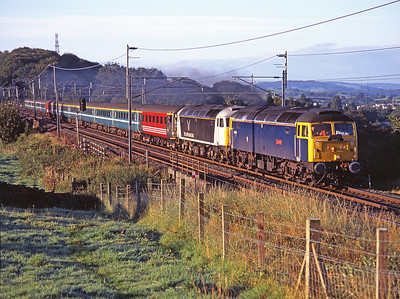 A 13 coach Compass tour from Preston-Aviemore heads north from Oxenholme hauled by 47839+47832 on Bank Holiday Monday 27/8/07.  47832 is in the short lived Victa Westlink livery.