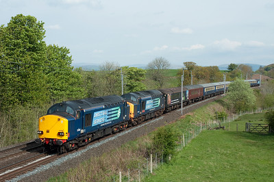 37608+37601 haul the Cruise Saver ECS from Kingmoor to Crewe near Oxenholme with 47810 on the rear, 7/5/12.