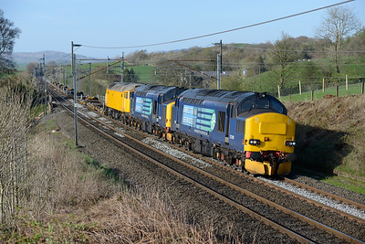 37259 + 37425 haul 57305 and a train of flats near Oxenholme 15/4/14.