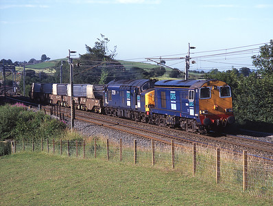 During 2006 Sellafield traffic was diverted over Shap while Leven viaduct was repaired.  20306 + 37259 are seen at Hayfell 14/7/06.