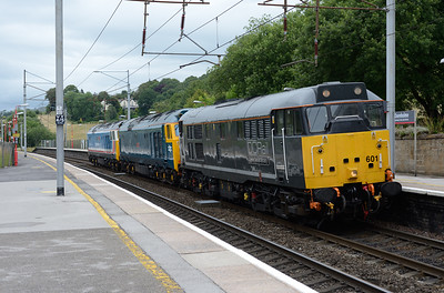 "31601 ""Devon Diesel Society"" hauls 50007 ""Hercules"" and 50017 ""Royal Oak"" through Oxenholme 2/8/15.  The locos were returning   from the Bo'ness & Kinneil Railway diesel gala."