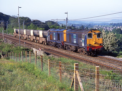 20313+20306 head north from Oxenholme with a diverted flask train 2/6/06.