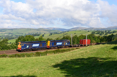 20309+20304 worked a container from Sellafield-Crewe via Shap 14/9/13 seen at Hayfell.