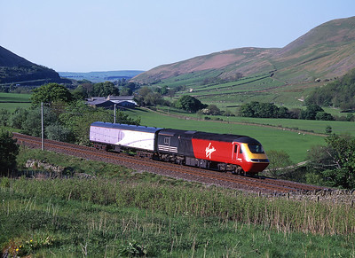 HST powercar 43100 passes through the Lune Gorge with a barrier coach on 19/5/98.