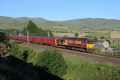 67020 passes Lowgill with failed class 325 Royal Mail units on 2/7/18.