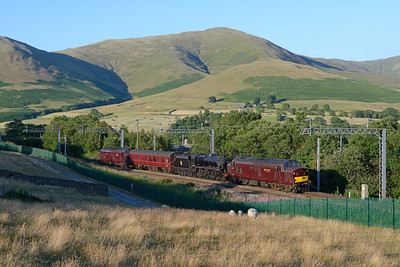 A Fort William-Carnforth convoy passes Lowgill on 9/7/18; 37668 leads black five 44871, its support coach and 37516.