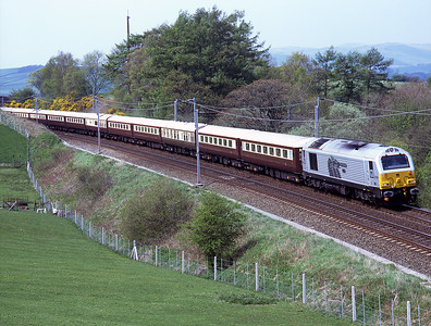 The empty stock from a Peterborough-Oxenholme Northern Belle passes Hardrigg behind 67029 7/5/08.