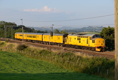 97303 heads north from Oxenholme with a Derby RTC-Carlisle measurement train at 06.45 on 25/7/14.