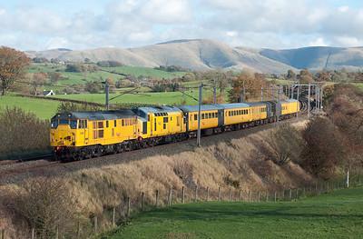 31285+97303 pass Docker with a Mossend-Derby test train 30/10/10.