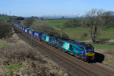 68002 + 68023 pass Docker with the Daventry-Mossend Tesco train 25/3/17.
