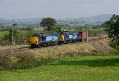 37605+37610 pass Docker with the regular Saturday container from Sellafield-Crewe 13/9/14.