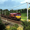 66010 approaches Oxenholme with an empty long welded rail train 16/8/2000.