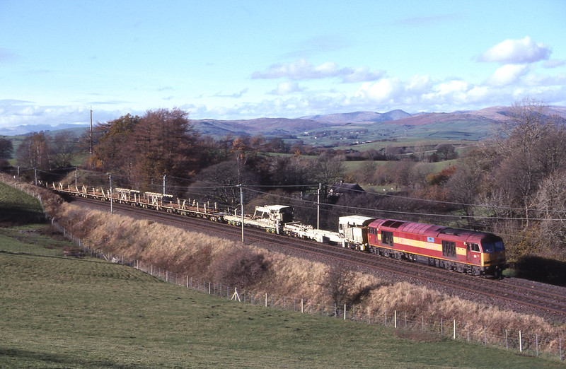 60019 Pathfinder Railtours takes the climb passed Hardrigg with an Oubeck - Carlisle engineers train, 7/11/2010.