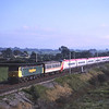 47150 with barrier vans and 390002 dead in tow passes Elmsfield with 4X70 Old Dalby Test Track to Tebay, 13/9/2002