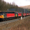 Not a sight us fans of AC locos like to see!<br /> 47829 hauls 86242 James Kennedy G.C. dead in tow on 1V50 08:40 Glasgow to Penzance service passed Beckfoot 17/3/2001.