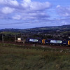 With Kendal Castle in the distance 37604 and 37510 lift their light load up the climb to Grayrigg 14/6/2011.