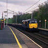 31466 rolls down the gradient through Oxenholme with a loaded ballast train from Shap 9/4/1998