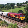 A new 66099 approaches Oxenholme with the Hardendale to Margam lime train 28/7/1999.