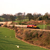 A rather new looking 66212 approaches Oxenholme with empty cartics, 6/4/2000.