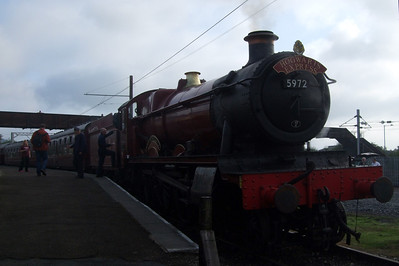 5972 Hogwarts Castle (Olton Hall) stands on the demonstration line at the platform at Carnforth.