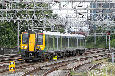 The 12.46 Euston to Crewe London Midland service arrives at Rugeley Trent Valley formed of 350101.