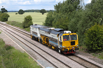 VolkerRail B42 UE Tamper DR75404 passes Willow Bottom Lane, Portway westbound.