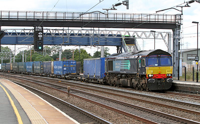 66431 brings the 4M44 08.47 Mossend to Daventry Malcolm Logistics Intermodal through Rugeley station.