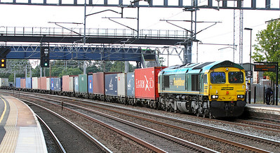 66592 'Johnson Stevens Agencies' heads through Rugeley Trent Valley on the slow lines with 4O29 15.18 Trafford Park to Southampton Freightliner.