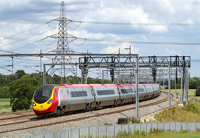 The 14.00 Euston to Manchester speeds northbound at Lichfield formed of Virgin Pendolino 390049.
