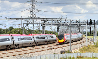 The 14.07 Euston to Liverpool Virgin Pendolino service formed of 390008 passes a southbound Pendolino service south of Lichfield Trent Valley.
