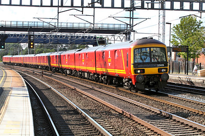 Three 325 units with 325005 leading pass Rugeley Trent Valley forming the 1A91 17.00 Warrington RMT to Willesden PRDC.